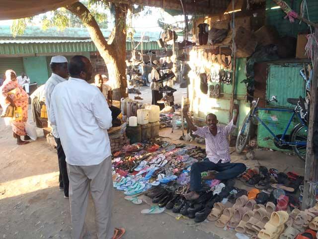 Sudan in dertien portretten - Vrolijke marktverkoper in Gedaref